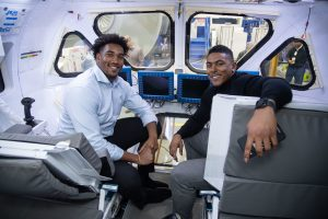 Eric Smith and Chris Peace try out the astronaut life from the driver seat at Johnson Space Center.